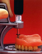 Assessing the existing denture.